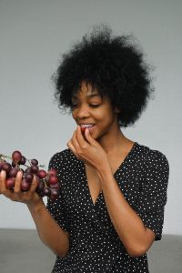 woman eating fresh grapes